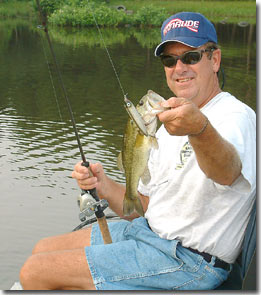 Pro bass angler Larry Nixon demonstrates the use of cankbaits.